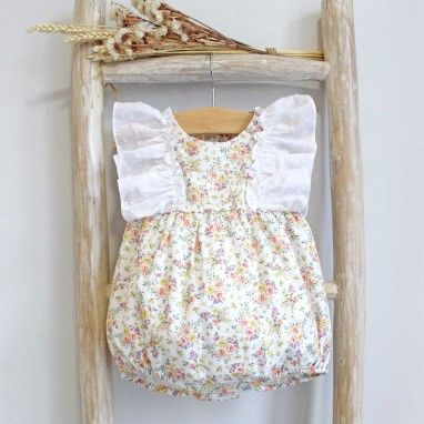 Floral Romper with plumeti frill