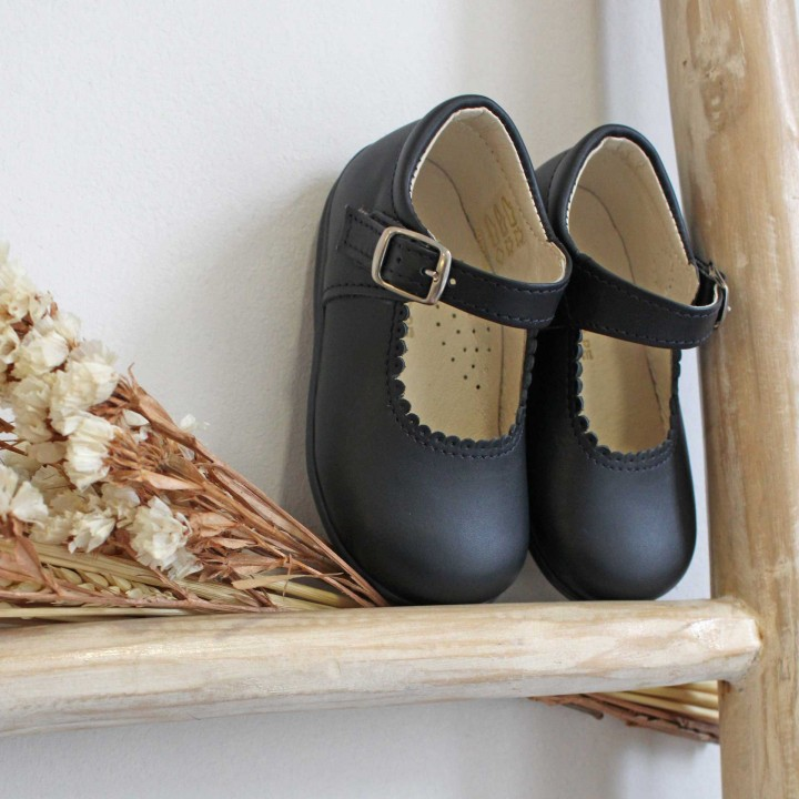 Leather Shoes with flexible rubber sole.