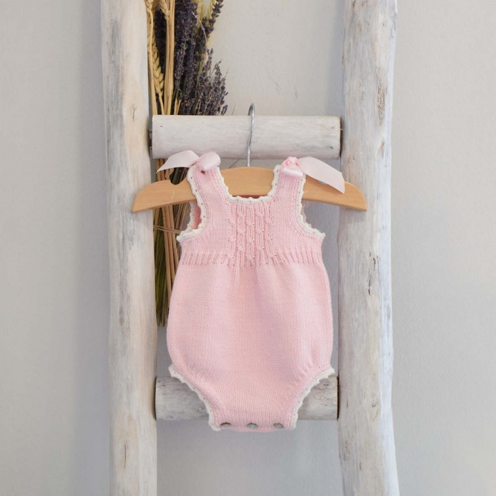 Knitted romper with shoulder bows