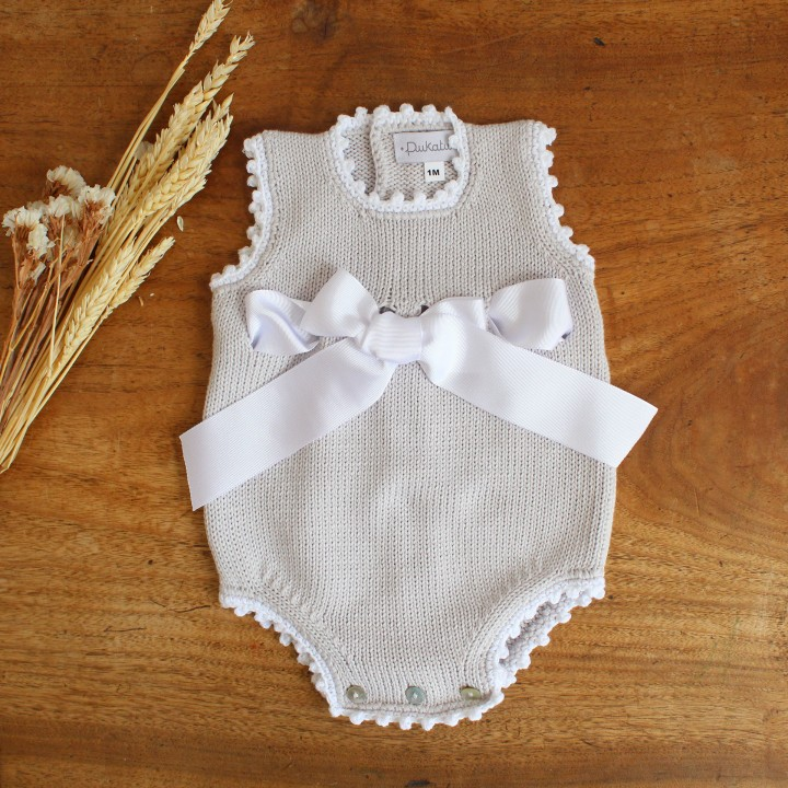 Cotton romper with Bow
